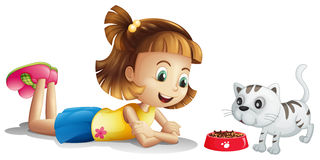 A young girl watching her pet eating Royalty Free Stock Photos