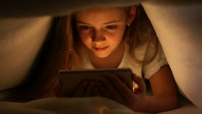 Young girl watching online content on her smartphone stock video