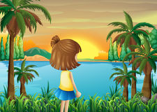 A young girl watching the river Stock Images
