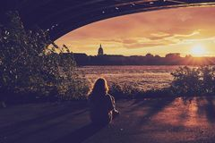 Young girl is watching the sunset, color matt look royalty free stock photos