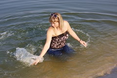 Young  girl in water Royalty Free Stock Photography
