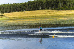 Young Girl Water-Skiing. On mountain lake summer Royalty Free Stock Photo