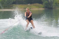 Young girl water skiing on slalom course Stock Image