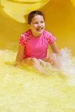 Young girl in water slide Royalty Free Stock Photo