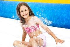 Girl Slide Aquapark. Young girl on water slide at aquapark. Summer holiday Royalty Free Stock Photo