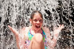 Young girl in a waterfall Royalty Free Stock Photo