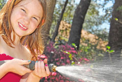 Young girl watering the flowers Royalty Free Stock Photography