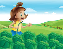 A young girl watering her plants at the garden Royalty Free Stock Image