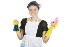 Young girl wearing apron and holding cleaning Royalty Free Stock Image