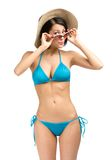 Young girl wearing bikini, hat and sunglasses Stock Photos