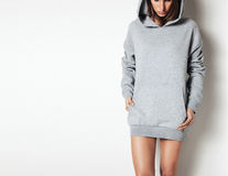 Young girl wearing blank and oversize long hoody. White background Stock Images