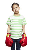 Young girl wearing boxing gloves sad and upset Stock Photos