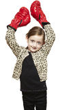 Young girl wearing boxing gloves smiling Royalty Free Stock Photo