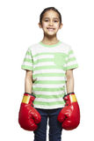 Young girl wearing boxing gloves smiling Stock Photography