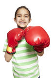 Young girl wearing boxing gloves smiling Stock Images