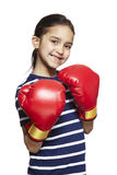 Young girl wearing boxing gloves smiling Royalty Free Stock Photography