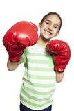 Young girl wearing boxing gloves smiling Stock Photos
