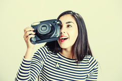 Young girl wearing casual cloth posing with instant camera. Stock Image