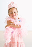 Young girl wearing crown and feather boa Stock Photography