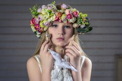 Young girl wearing floral head dress Royalty Free Stock Photography