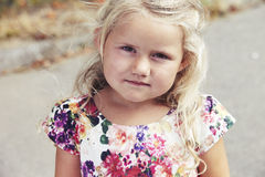 Young girl wearing a flower dress Royalty Free Stock Images