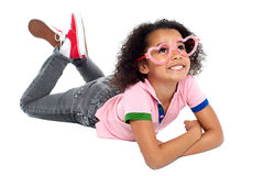 Young girl wearing funny heart shaped frame Royalty Free Stock Image
