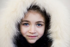 Young girl with wearing fur hat Stock Image