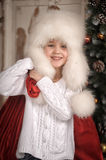 Young girl with wearing fur hat. Royalty Free Stock Photography