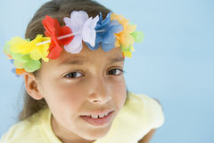 Young girl wearing garland on head. Looking at camera Royalty Free Stock Image