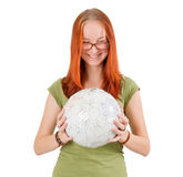 Young girl wearing glasses holding globe. Stock Photography