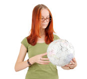Young girl wearing glasses holding globe. Royalty Free Stock Photos