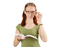 Young girl wearing glasses holding textbook. Royalty Free Stock Photo