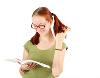 Young girl wearing glasses holding textbook. Royalty Free Stock Photos