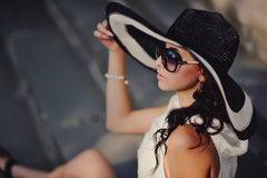 Young girl wearing a hat. Fashion girl wearing a hat  and posing Stock Photo