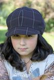Young girl wearing a hat stock image