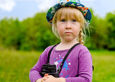 Young girl wearing a hat with binoculars Stock Photos
