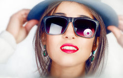 Young  girl wearing a hat and sunglasses Royalty Free Stock Image