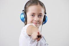 Young girl wearing headphones Stock Photography