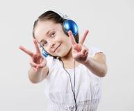 Young girl wearing headphones Stock Photo
