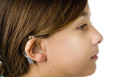 Young girl wearing a hearing aid