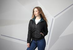 Young girl girl wearing  jacket with area for your logo, mock-up of white women hoodie stock photo