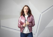 Young girl girl wearing  jacket with area for your logo, mock-up of white women hoodie royalty free stock photos