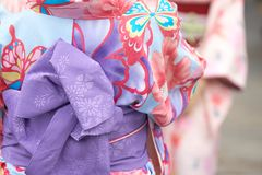 Young girl wearing Japanese kimono standing in front of Sensoji Temple in Tokyo, Japan. Kimono is a Japanese traditional garment. The word `kimono`, which Royalty Free Stock Photos