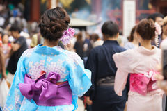 Young girl wearing Japanese kimono standing in front of Sensoji Temple in Tokyo, Japan. Kimono is a Japanese traditional garment. Stock Photography
