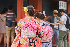 Young girl wearing Japanese kimono standing in front of Sensoji Temple in Tokyo, Japan. Kimono is a Japanese traditional garment. Stock Image
