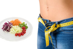 Young girl wearing jeans after diet and food background Stock Photo