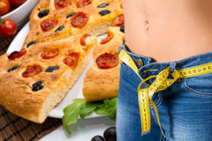 Young girl wearing jeans after diet and food background Stock Image