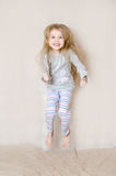 Young Girl Wearing Pajamas Jumping Stock Images