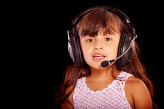 Young girl wearing phone headset Royalty Free Stock Photos