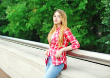 Young girl wearing a pink checkered shirt outdoors Royalty Free Stock Image